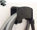 Support mural en plastique noir pour flexible aspirateur